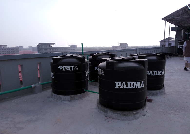 In this Thursday, Dec. 19, 2019 photo, water storage tankers atand on the roof of a newly constructed building on Bhasan Char, or floating island, in the Bay of Bengal, Bangladesh. The island in Bangladesh that was regularly submerged during monsoon seasons is ready to house 100,000 Rohingya refugees, but no date has been announced to begin relocating people from crowded and squalid camps on the country's border with Myanmar, officials said Thursday. The island is built to accommodate 100,000 people, just a fraction of the million Rohingya Muslims who have fled waves of violent persecution in their native Myanmar. (AP Photo/Saleh Noman)