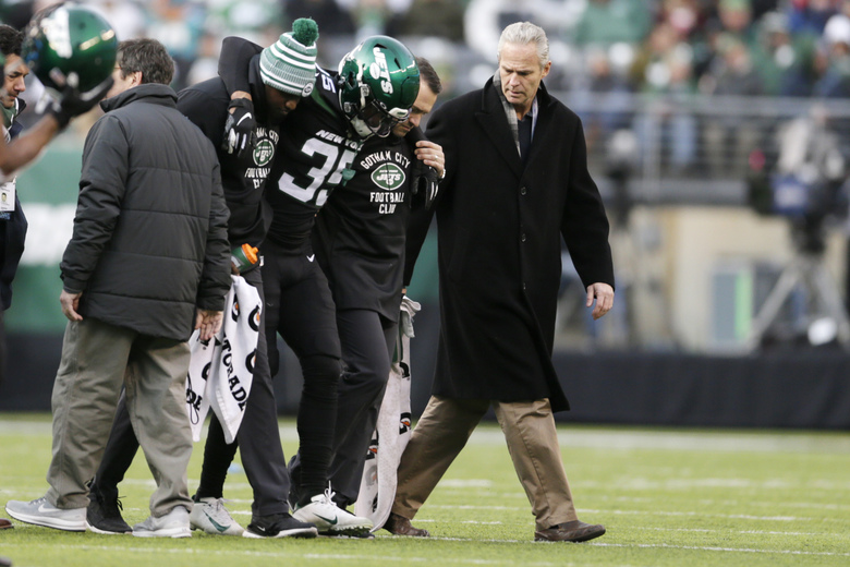 "FILE – In this Dec. 8, 2019, file photo, New York Jets cornerback Kyron Brown (35) is helped off the field after being injured during the second half of an NFL football game against the Miami Dolphins in East Rutherford, N.J. The New York Jets finished the season with a league-high 20 players on injured reserve and had so many other injuries the organization is studying every step from practice to recovery down to how they care for injuries to stay healthier in the future. Jets general manager Joe Douglas hopes 2019 was a ""bit of anomaly."" (AP Photo/Adam Hunger, File)"
