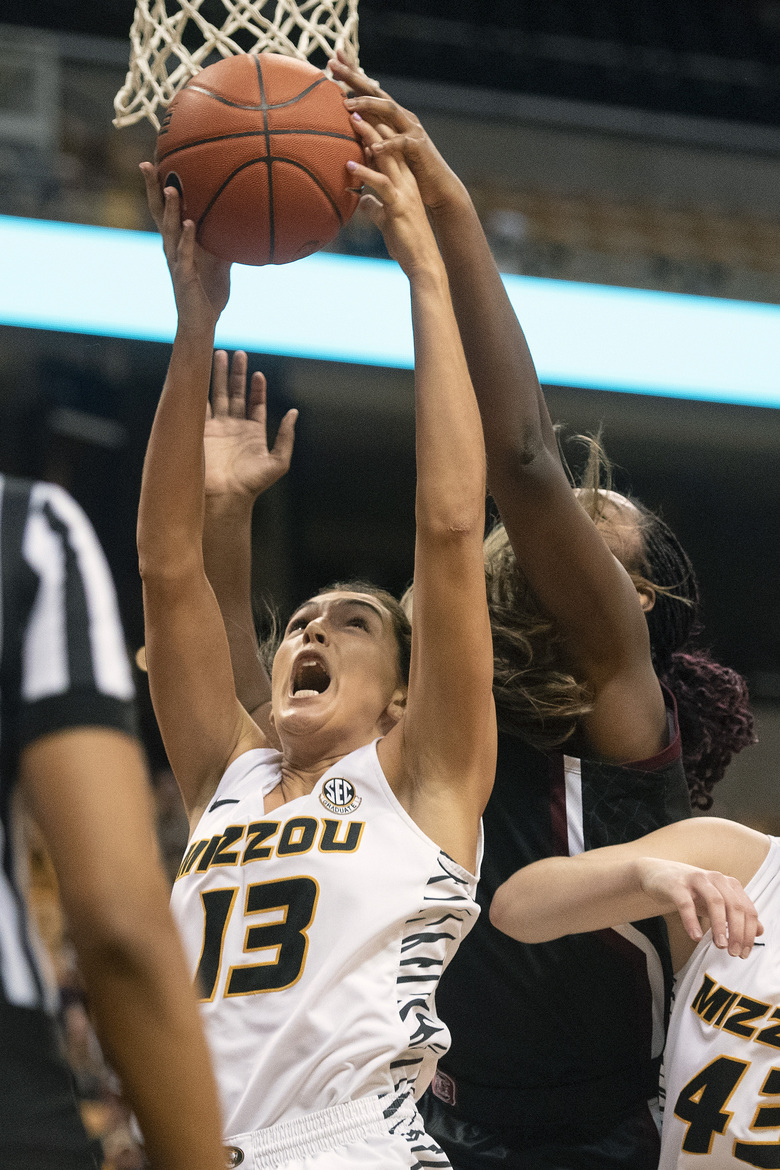 Missouri's Hannah Schuchts, left, pulls down a rebound in front of South Carolina's Aliyah Boston, left, during the first half of an NCAA college basketball game Thursday, Jan. 16, 2020, in Columbia, Mo. (AP Photo/L.G. Patterson)