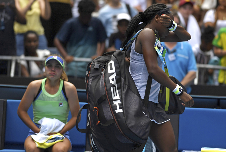 Coco Gauff, right, of the U.S. reacts as she walks from the court following her fourth round loss to compatriot Sofia Kenin, left, at the Australian Open tennis championship in Melbourne, Australia, Sunday, Jan. 26, 2020. (AP Photo/Andy Brownbill)