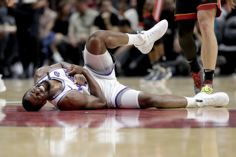 Sacramento Kings forward Harrison Barnes falls to the court during the first half of an NBA basketball game against the Miami Heat, Monday, Jan. 20, 2020, in Miami. (AP Photo/Lynne Sladky)