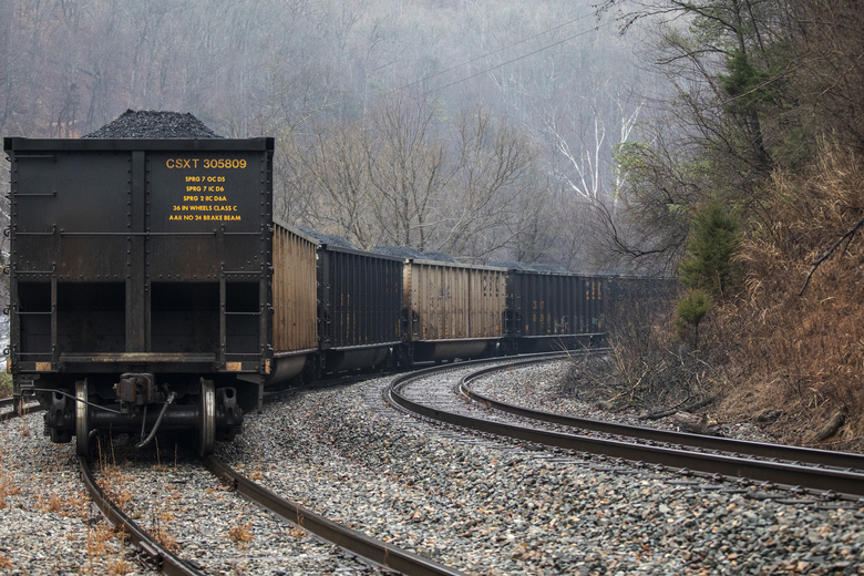 In this Tuesday, Jan. 14, 2020, photo, train cars filled with coal sit idle as miners, who say they haven't been paid in nearly three weeks, block a coal train in the Kimper area of Pike County, Ky. The miners said they won't return to work until their paychecks are in their bank accounts. (Ryan C. Hermens/Lexington Herald-Leader via AP)