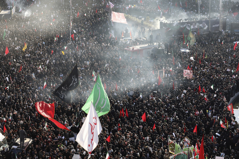 Mourners attend a funeral ceremony for Iranian Gen. Qassem Soleimani and his comrades, who were killed in Iraq in a U.S. drone strike on Friday, at the Enqelab-e-Eslami (Islamic Revolution) square in Tehran, Iran, Monday, Jan. 6, 2020. (AP Photo/Ebrahim Noroozi)