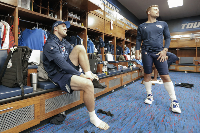 Tennessee Titans quarterback Ryan Tannehill, left, and punter Brett Kern, right, talk in the locker room before an NFL football practice Thursday, Jan. 16, 2020, in Nashville, Tenn. The Titans are scheduled to face the Kansas City Chiefs in the AFC Championship game Sunday. (AP Photo/Mark Humphrey)