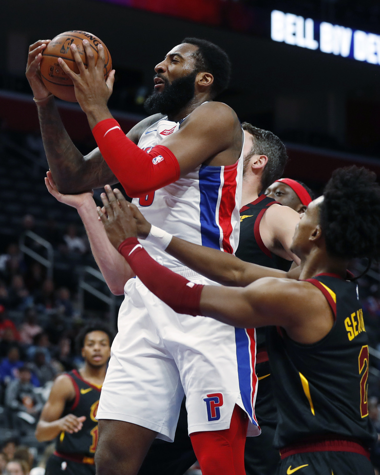 Detroit Pistons center Andre Drummond pulls down a rebound during the first half of the team's NBA basketball game against the Cleveland Cavaliers, Thursday, Jan. 9, 2020, in Detroit. (AP Photo/Carlos Osorio)