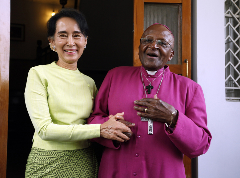 FILE – In this Feb. 26, 2013, file photo, South African Archbishop Desmond Tutu, right, and Myanmar opposition leader Aung San Suu Kyi speak during a press briefing after the Nobel laureates' meeting at her residence in Yangon, Myanmar. As the magnitude of the Rohingya tragedy emerged, 1984 Nobel Peace laureate Archbishop Desmond Tutu felt compelled to appeal to Suu Kyi. (AP Photo/Khin Maung Win, File)