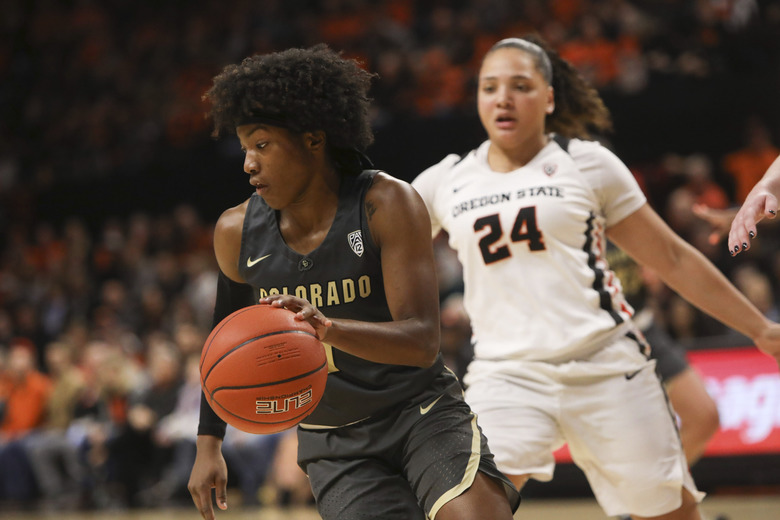 Colorado's Jaylyn Sherrod (1) turns back to the middle, away from Oregon State's Destiny Slocum (24) during the first half of an NCAA college basketball game in Corvallis, Ore., Sunday, Jan. 5, 2020. (AP Photo/Amanda Loman)