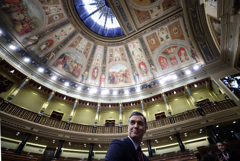 Spain's caretaker Prime Minister Pedro Sanchez poses for photographers at the Spanish parliament in Madrid Tuesday, Jan. 7, 2020. Spain's parliament chose Socialist leader Pedro Sánchez to form a new government Tuesday, ending almost a year of political limbo for the eurozone's fourth-largest economy. Sánchez won a cliff-hanger confidence vote 167-165, with 18 abstentions. It was the slimmest victory for a prime minister candidate in decades.(AP Photo/Manu Fernandez)