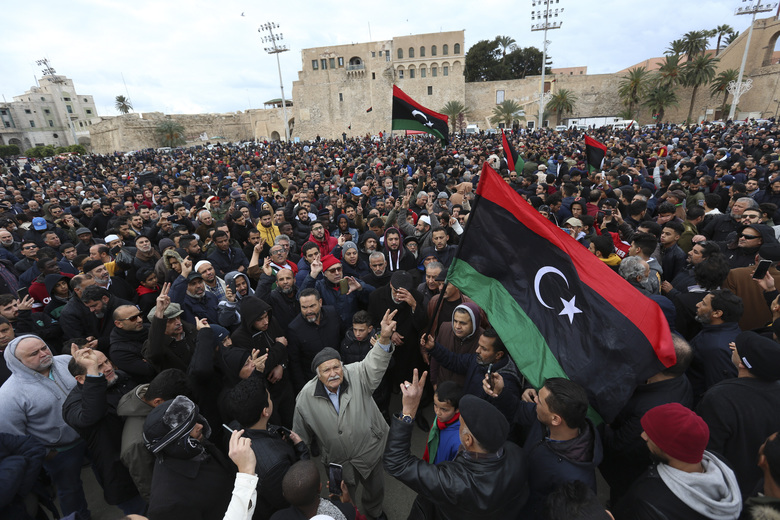 People attend a funeral of military cadets in Tripoli, Libya, Sunday, Jan. 5, 2020. Health officials said the death toll from the airstrike climbed to at least 30 people, most of them students and over 30 others were wounded. The airstrike took place in the city's south late Saturday, an area which has seen heavy clashes in recent months. Forces based in eastern Libya and led by Gen. Khalifa Hifter have been fighting to seize the capital from the weak but U.N.-supported government. (AP Photo/Hazem Ahmed)