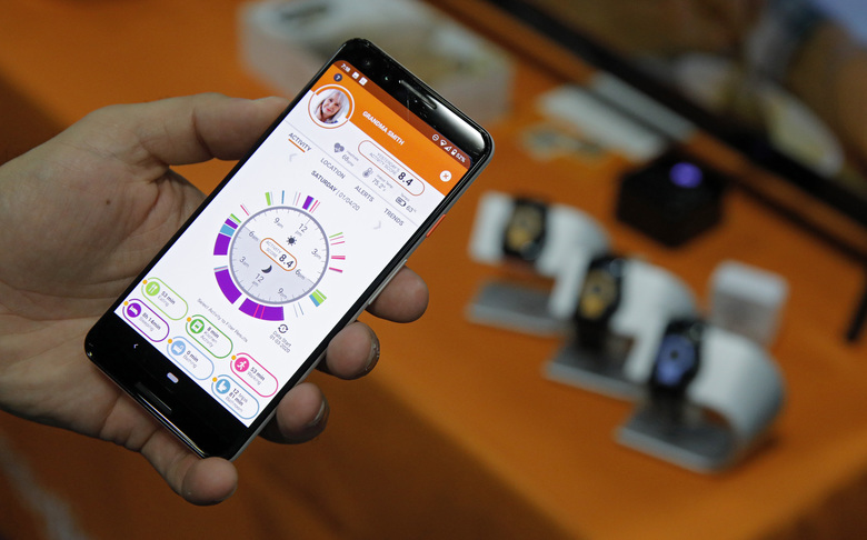 The app for the CarePredict Tempo Series 3 appears on display at the CarePredict booth during CES Unveiled before CES International, Sunday, Jan. 5, 2020, in Las Vegas. The wearable device for seniors detects changes in the senior's activity and can alert caregivers and family. (AP Photo/John Locher)