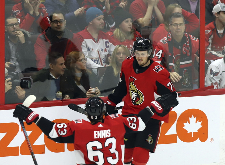 Ottawa Senators defenseman Thomas Chabot (72) celebrates his goal against the Washington Capitals with right wing Tyler Ennis (63) during the second period of an NHL hockey game Friday, Jan. 31, 2020, in Ottawa, Ontario. (Fred Chartrand/The Canadian Press via AP)