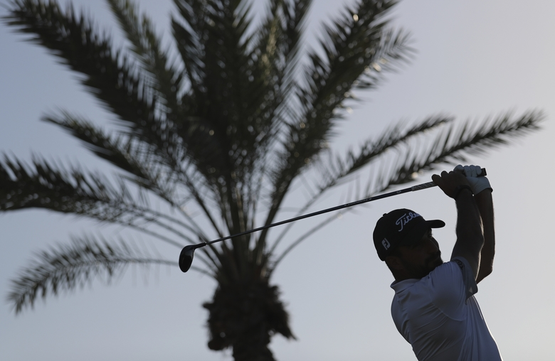 Italy's Francesco Laporta tees off on the 18th hole during the third round of the Abu Dhabi Championship golf tournament in Abu Dhabi, United Arab Emirates, Saturday, Jan. 18, 2020. (AP Photo/Kamran Jebreili)