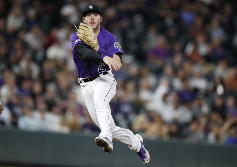 FILE – In this Sept. 17, 2019, file photo, Colorado Rockies shortstop Trevor Story throws to first base to put out New York Mets' Marcus Stroman during the sixth inning of a baseball game in Denver.  Story asked for $11.5 million and the Rockies offered him $10.75 million when players and teams exchanged proposed salaries in salary arbitration Friday, Jan. 10. Colorado catcher Tony Wolters also could be headed toward a hearing next month after requesting a raise from $960,000 to $2,475,000. The Rockies offered $1.9 million. (AP Photo/David Zalubowski, File)