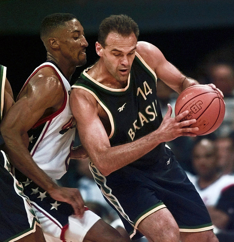 FILE – In this Tuesday, July 30, 1996 file photo, Brazil's Oscar Schmidt (14) drives past Scottie Pipen (8) of the United States during the quarterfinals of basketball competition at the Centennial Summer Olympic Games in Atlanta. For little Kobe Bryant growing up in Italy the player that amazed him as a child was skinny and half-bald Brazilian guard Oscar Schmidt.  (AP Photo/Hans Deryk, File)