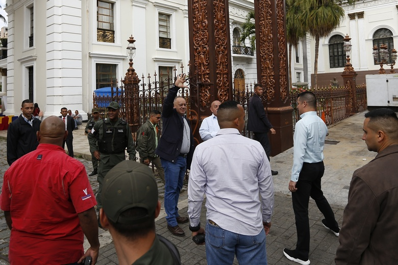 Diosdado Cabello, president of the National Constituent Assembly, waves as he arrives for a special session marking Teacher's Day at the National Assembly in Caracas, Venezuela, Wednesday, Jan. 15, 2020. (AP Photo/Ernesto Vargas)