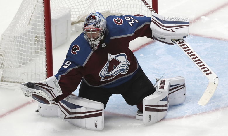 Colorado Avalanche goaltender Pavel Francouz gloves the puck, against the Pittsburgh Penguins during the third period of an NHL hockey game Friday, Jan. 10, 2020, in Denver. Pittsburgh won 4-3 in overtime. (AP Photo/David Zalubowski)