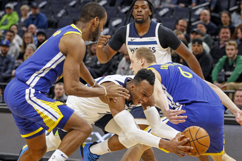 Minnesota Timberwolves guard Josh Okogie (20) drives between Golden State Warriors guard Alec Burks (8) and forward Alen Smailagic (6) and gets fouled in the first half of an NBA basketball game Thursday, Jan. 2, 2020, in Minneapolis. (AP Photo/Bruce Kluckhohn)