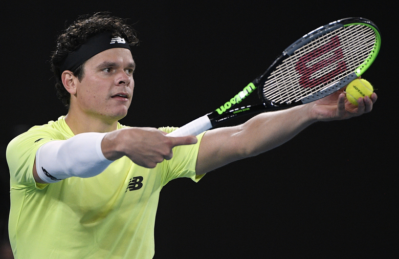 Canada's Milos Raonic prepares to serve to Serbia's Novak Djokovic during their quarterfinal match at the Australian Open tennis championship in Melbourne, Australia, Tuesday, Jan. 28, 2020. (AP Photo/Andy Brownbill)