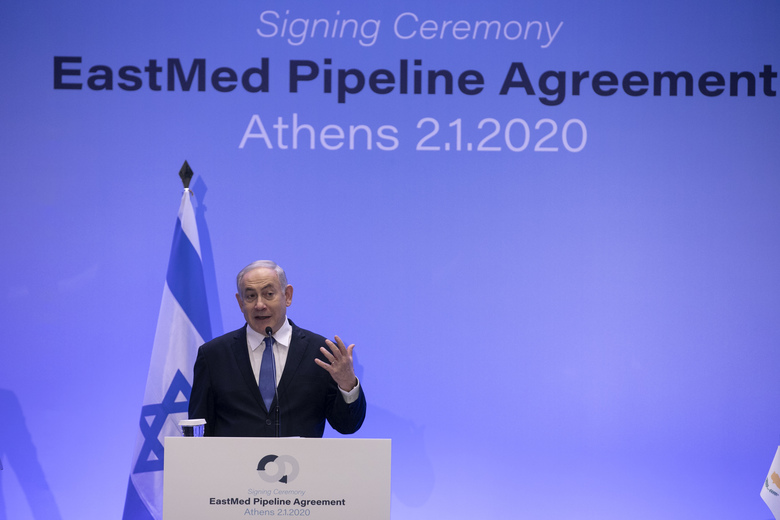 Israeli Prime Minister Benjamin Netanyahu speaks during a joint news briefing with Greece's Prime Minister Kyriakos Mitsotakis, and Cypriot President Nicos Anastasiadis, in Athens, Thursday, Jan. 2, 2020. The leaders of Greece, Israel and Cyprus met in Athens Thursday to sign a deal aiming to build a key undersea pipeline, named EastMed, designed to carry gas from new rich offshore deposits in the southeastern Mediterranean to continental Europe. (AP Photo/Yorgos Karahalis)