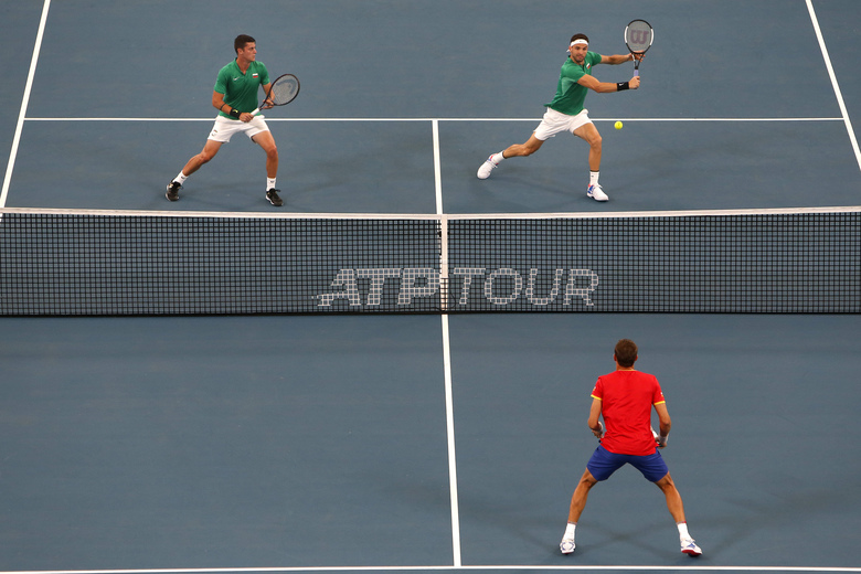 Grigor Dimitrov  and Alexandar Lazarov of Bulgaria play a shot in their doubles game against Radu Albot and Alexander Cozbinov of Moldova during their ATP Cup tennis match in Sydney, Sunday, Jan. 5, 2020. (AP Photo/Steve Christo)