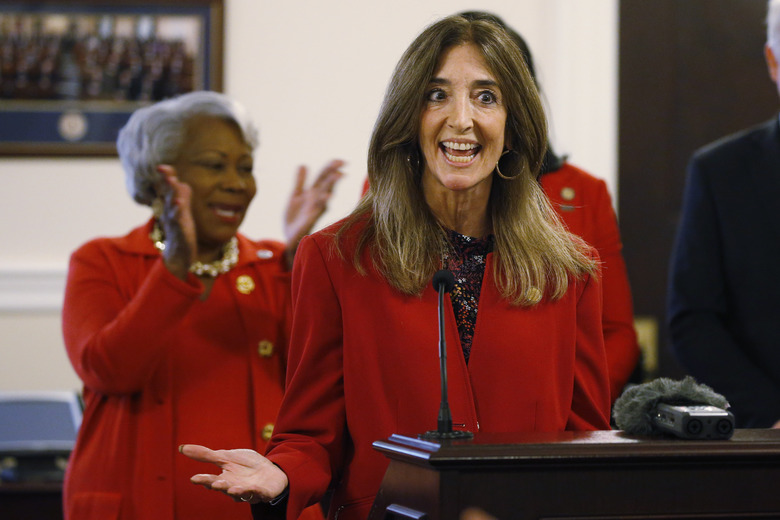 House speaker, Eileen Filler-Corn, D-Fairfax, right, applauds speaks during a press conference along with Senate president Pro-tempore, Sen. Louise Lucas, D-Portsmouth, as they participate in a press conference promoting the ERA at the Capitol, Monday Jan 27, 2020, in Richmond, Va. (AP Photo/Steve Helber)