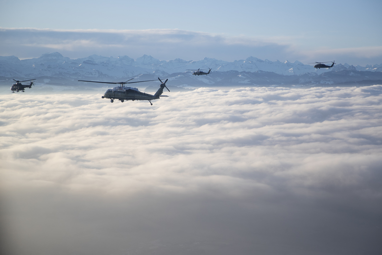Marine One carrying US President Donald Trump travels to the Davos landing zone in Switzerland, Tuesday, Jan. 21, 2020. President Trump arrived in Switzerland on Tuesday to start a two-day visit to the World Economic Forum. (AP Photo/Evan Vucci)