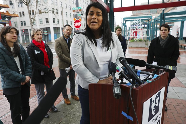 Monserrat Padilla, director of the Washington Immigrant Solidarity Network, speaks at a news conference in Seattle Tuesday about rumors of immigration agents patrolling public transit. (Ken Lambert / The Seattle Times)