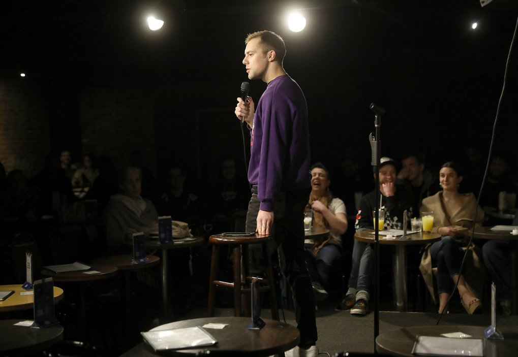 Bo Johnson performs at open mic night at the Comedy Underground. Johnson says the three- minute time limit everyone is given challenges him to focus, adding that he sometimes might not know what he will perform until he hits the stage. (Ken Lambert / The Seattle Times)