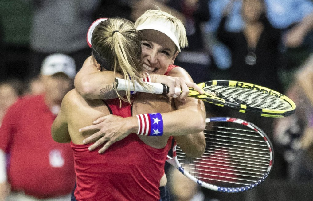 Bethanie Mattek-Sands, facing camera, and Sofia Kenin celebrate match point over Latvia in the Fed Cup Saturday night.  The win gave the US the team victory. (Dean Rutz / The Seattle Times)