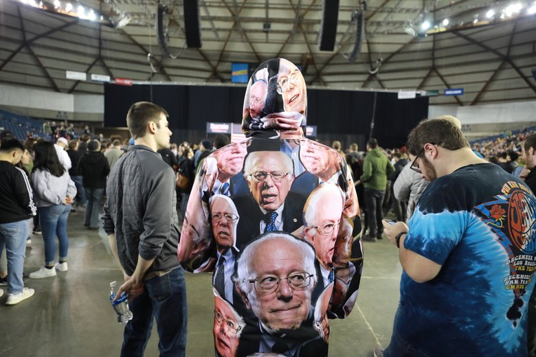 Nicolas Wiggins of Puyallup wore his support for Sen. Bernie Sanders on his sleeve and all over his jumpsuit at the Tacoma Dome on Monday.  (Steve Ringman / The Seattle Times)