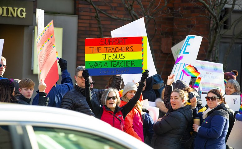 Protesters outside the  Seattle Catholic Archdiocese pointed to what they called a contradiction between Jesus' message of acceptance and love and the Catholic Church's strict policies on morality. (Mike Siegel / The Seattle Times)