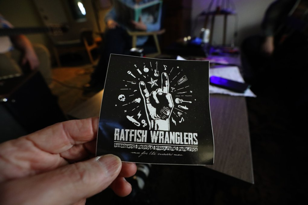 "This Ratfish Wrangler sticker says the band plays ""subaquatic neofolk fishy-funk punk-rock."" (Alan Berner / The Seattle Times)"