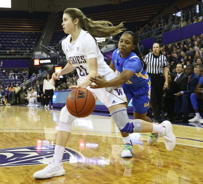 University of Washington guard Rita Pleskevich heads to the basket with UCLA guard Charisma Osborne in pursuit in the first half, Sunday, Feb. 23, 2020, in Seattle.  (Ken Lambert / The Seattle Times)