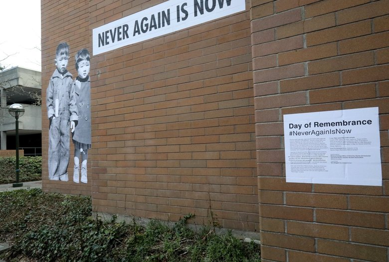 An art installation by Seattle artist Erin Shigaki, placed on a Bellevue College building, depicts two Japanese American children incarcerated by the U.S. government during World War II. (Greg Gilbert / The Seattle Times)