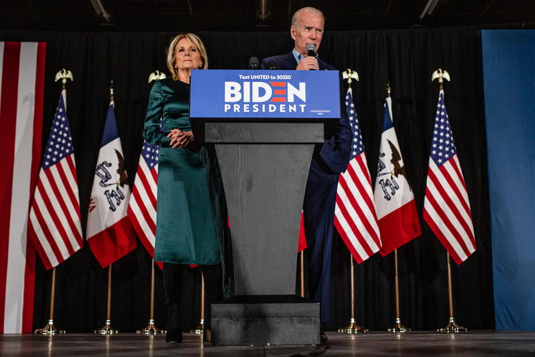 Former Vice President Joe Biden, a Democratic presidential candidate, is accompanied by his wife, Jill Biden, as he speaks at a caucus night party in Des Moines, Iowa, Feb. 3, 2020. The Iowa presidential caucuses took place Monday night at more than 1,600 sites across the state. (Jordan Gale/The New York Times)
