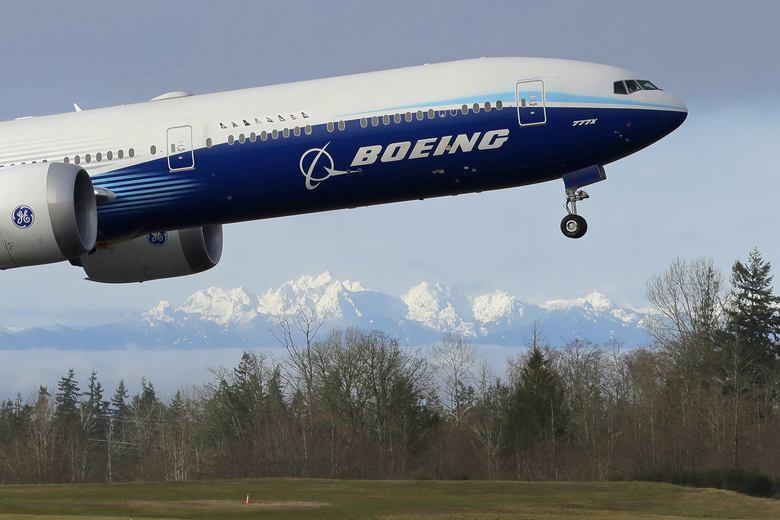 A Boeing 777X airplane takes off at Paine Field in Everett in January. Boeing recently entered into a partnership to recycle excess composite material into car parts, computer cases and other products. (AP Photo / Ted S. Warren, File)