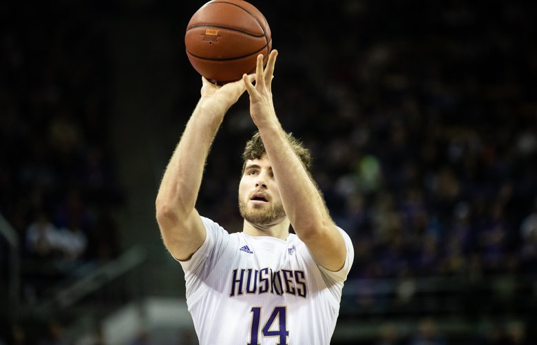 Washington Huskies forward Sam Timmins (14) shoots a free-throw during the second half of the NCAA men's basketball game between University of Washington and UCLA on at Alaska Airlines Arena on Jan. 2, 2020. 212552