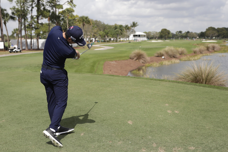 Ryo Ishikawa of Japan hits from the 16th tee during the Pro-Am of the Honda Classic golf tournament, Wednesday, Feb. 26, 2020, in Palm Beach Gardens, Fla. (AP Photo/Lynne Sladky)