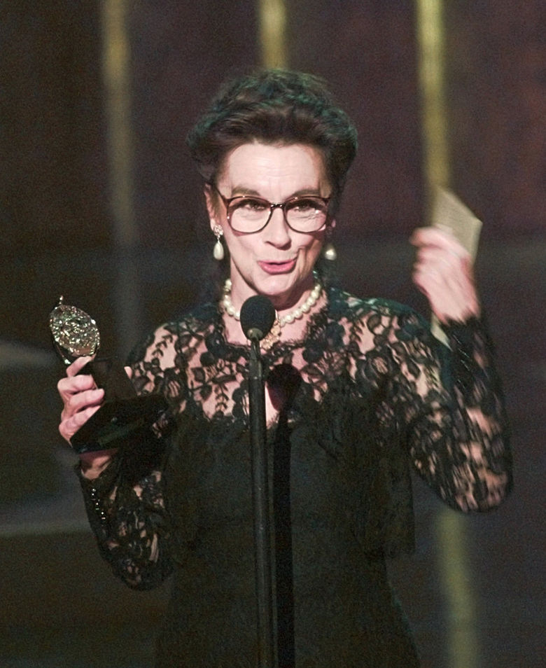 """FILE – In this June 2, 1996, file photo, Zoe Caldwell holds her award for Leading Actress in a Play for her role in """"Master Class"""" at the 50th Annual Tony Awards in New York. Caldwell, a four-time Tony Award winner famous for portraying larger-than-life characters, has died. Her son Charlie Whitehead said Caldwell died peacefully Sunday, Feb. 16, 2020, at her home in Pound Ridge, New York. She was 86. Whitehead said her death was due to complications from Parkinson's disease. (AP Photo/Ron Frehm, File)"""
