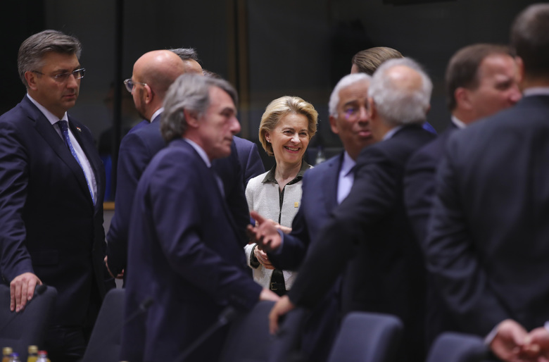 European Commission President Ursula von der Leyen, center, attends a round table meeting at an EU summit in Brussels, Thursday, Feb. 20, 2020. After almost two years of sparring the EU will be discussing the bloc's budget, to work out Europe's spending plans for the next seven years. (AP Photo/Olivier Matthys)