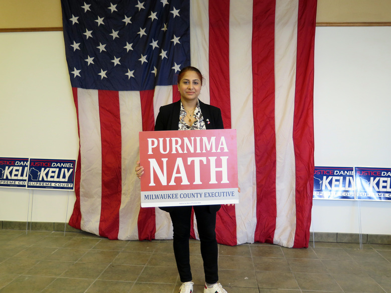 In this Friday, Jan. 31, 2020, photo, Purnima Nath holds a campaign sign for her candidacy for Milwaukee County Executive at the GOP's first-ever campaign office in the heart of city. The new office is part of a renewed effort by Republicans to reach out to minority voters in the Democratic stronghold of Milwaukee. The county executive position is non-partisan, but Nath said she identifies more with the Republican Party. (AP Photo/Ivan Moreno)