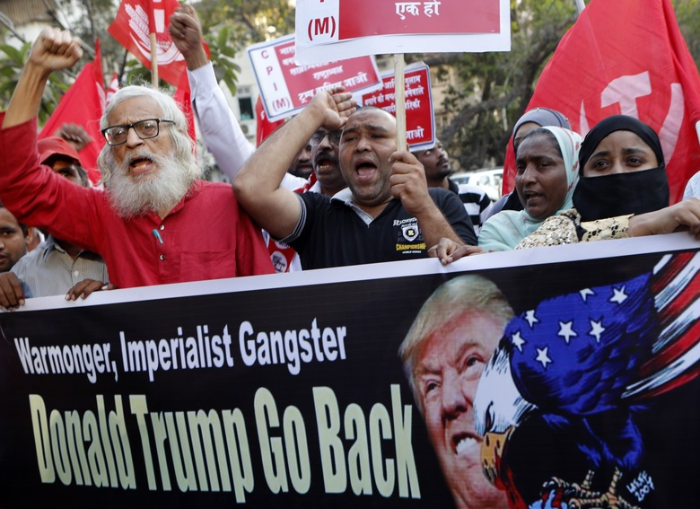 Supporters of the Communist Party of India -Marxist protest against the India visit of US President Donald Trump in Mumbai, India, Tuesday, Feb 25, 2020. (AP Photo/Rajanish Kakade)