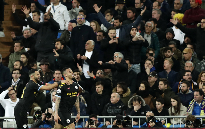 Manchester City's Gabriel Jesus, right, celebrates after scoring his side's opening goal during the Champions League, round of 16, first leg soccer match between Real Madrid and Manchester City at the Santiago Bernabeu stadium in Madrid, Spain, Wednesday, Feb. 26, 2020. (AP Photo/Manu Fernandez)