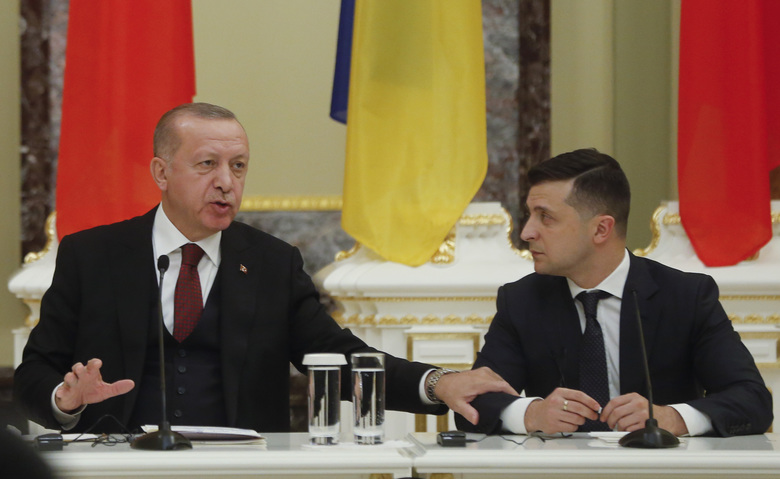 Ukrainian President Volodymyr Zelenskiy, right, and Turkey's President Recep Tayyip Erdogan attend a joint news conference following their talks in Kyiv, Ukraine, Monday, Feb. 3, 2020. (AP Photo/Efrem Lukatsky)