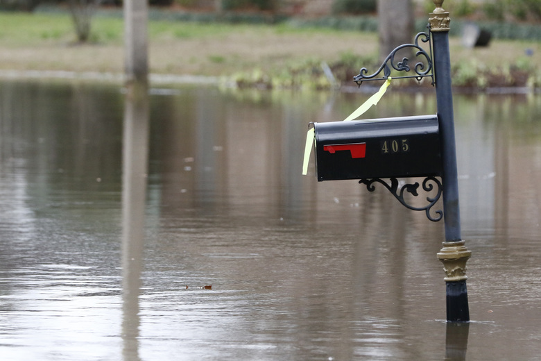 A mailbox that was almost underwater Monday, is now a couple of feet above the Pearl River floodwaters on North Canton Club Circle in Jackson, Miss., Tuesday afternoon, Feb. 18, 2020. Officials have limited entry to the flooded neighborhoods as they have warned residents about the contamination of the receding waters and the swift currents. (AP Photo/Rogelio V. Solis)