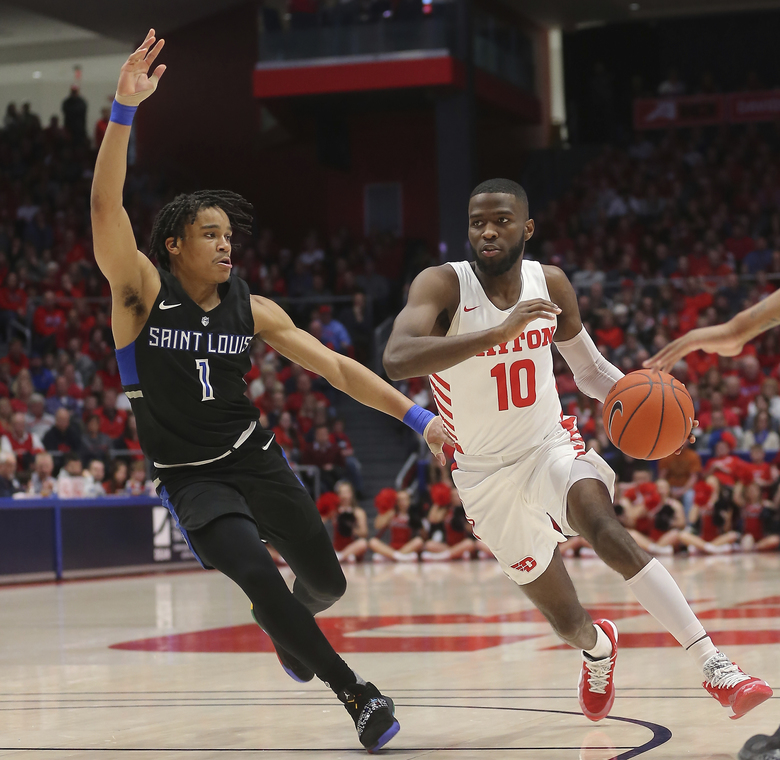 Dayton's Jalen Crutcher (10) drives to the basket against St. Louis guard Yuri Collins (1) during the first half of an NCAA college basketball game, Saturday, Feb. 8, 2020, in Dayton, Ohio. (AP Photo/Tony Tribble)