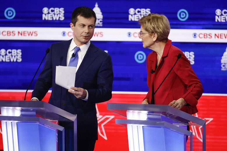 Democratic presidential candidates,former South Bend Mayor Pete Buttigieg, left, and Sen. Elizabeth Warren, D-Mass., right, prepare to leave the stage after participating in a Democratic presidential primary debate at the Gaillard Center, Tuesday, Feb. 25, 2020, in Charleston, S.C., co-hosted by CBS News and the Congressional Black Caucus Institute. (AP Photo/Patrick Semansky)