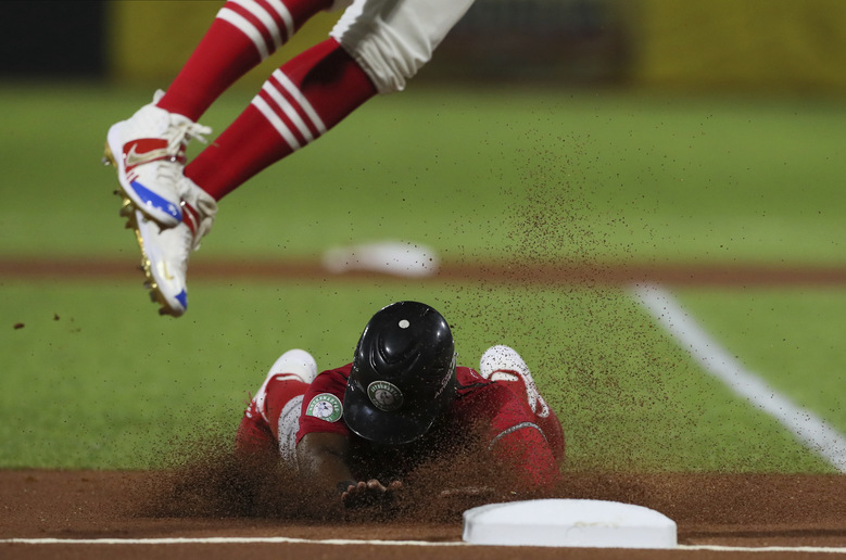 Panama's Rodrigo Orozco slides in safe at third base during a Caribbean Series baseball game against Puerto Rico in San Juan, Puerto Rico, Saturday, Feb. 1, 2020. (AP Photo/Fernando Llano)