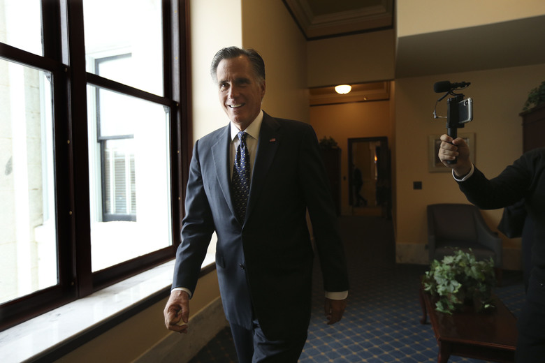 Sen. Mitt Romney, R-Utah, walks through a hallway at the state Capitol in Salt Lake City on Thursday, Feb. 6, 2020.   Republicans in the state are unusually divided on the president, so while some were heartened to see Romney cast what he described as an agonizing vote dictated by his conscience, Trump supporters were left angry and frustrated.  (Laura Seitz/The Deseret News via AP)