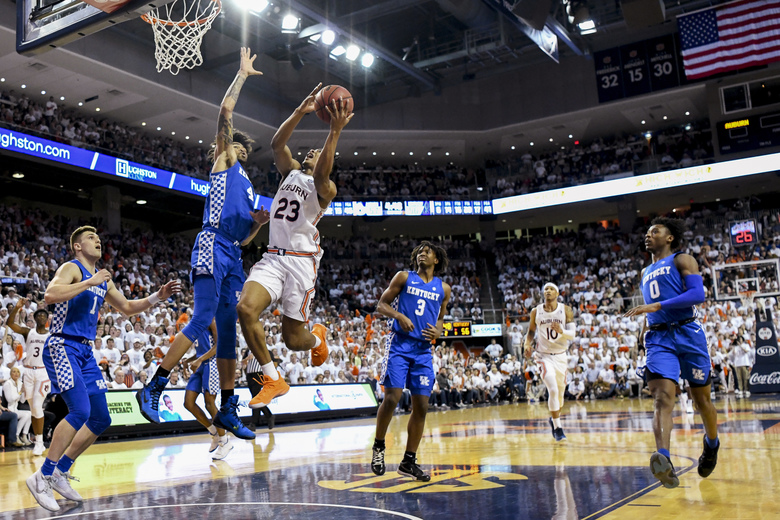 Kentucky forward Nick Richards (4) defends against a shot by Auburn forward Isaac Okoro (23) during the second half of an NCAA college basketball game Saturday, Feb. 1, 2020, in Auburn, Ala. (AP Photo/Julie Bennett)